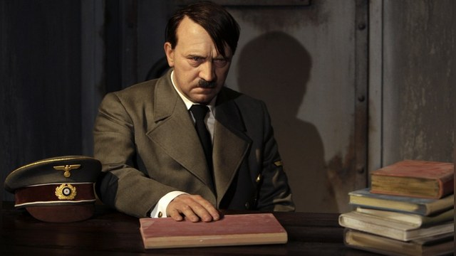 A waxwork of Adolf Hitler before a 41-year-old man tore its head off from the controversial exhibit on the opening day of Berlin's Madame Tussauds July 5, 2008 is seen in this July 3, 2008 file photo. The man was arrested by police after he jumped over the desk and ripped off the head of the waxwork figure in protest of the controversial exhibit that showed a glum-looking Adolf Hitler behind his desk in a mock bunker during the last days of his life.   REUTERS/Tobias Schwarz/Files  (GERMANY) - RTX7NQ0