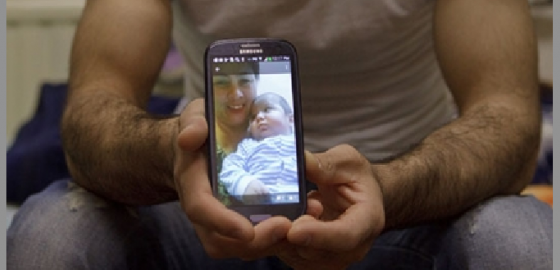 Rustam Nazarov displays a photo of his late son Umarali on the screen of his telephone. Photo: Elena Lukyanova
