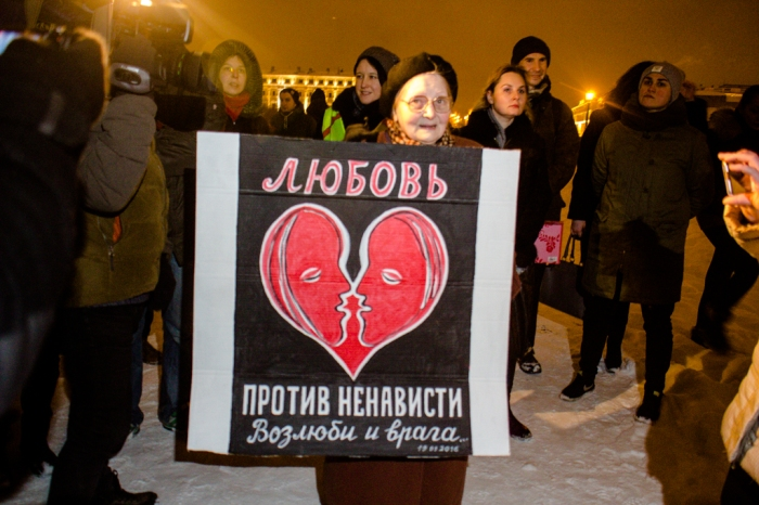 """Local artist Yelena Osipova, a fixture at opposition protests in Petersburg, holds a homemade placard that reads, """""""