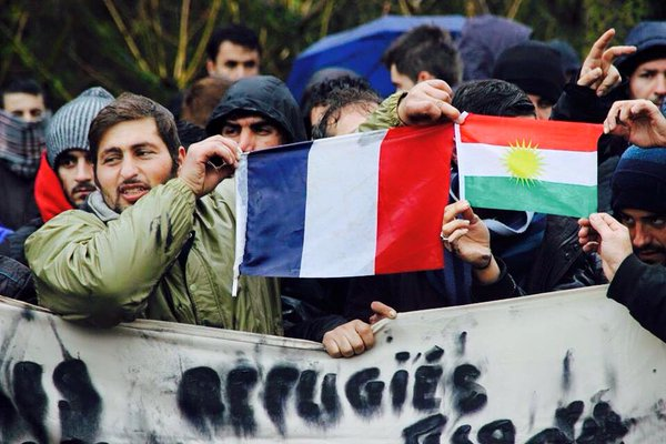 Refugees in Europe demonstrate in support of France and against ISIS terrorism. Photo by Hafsa Sabr. Courtesy of Maria José Ferreiro