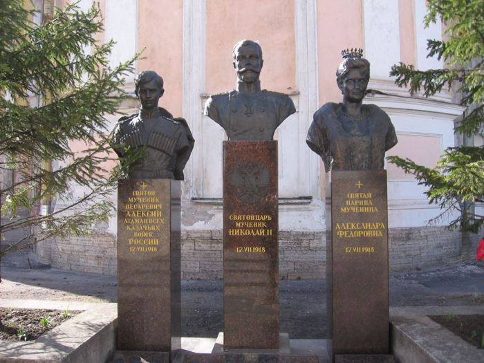 "Busts of the Tsetsarevich Alexei, Emperor Nicholas II, and Empress Alexandra, all identified as ""holy martyrs,"" outside the Theotokos of Tikhvin Church, Petrograd, April 25, 2015. Photo by the Russian Reader"
