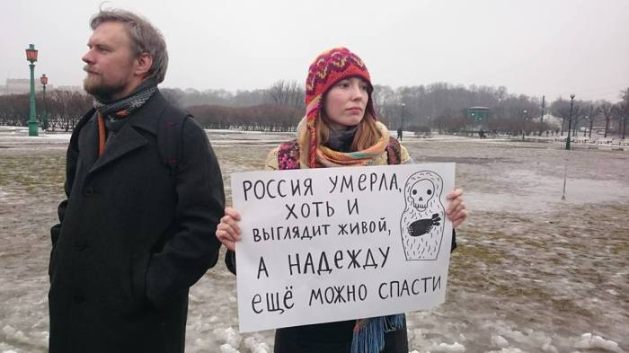 """Russia is dead, although it seems to be alive. But Nadiya can be saved."" Demonstrator at International Women's Day rally on the Field on Mars, Petrograd, March 8, 2016. Photo by and courtesy of Sergey Chernov"