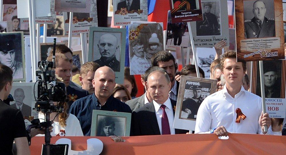 Vladimir Putin leading Immortal Regiment march in Moscow, May 9, 2016. Photo: Ilya Pitalev/Sputnik
