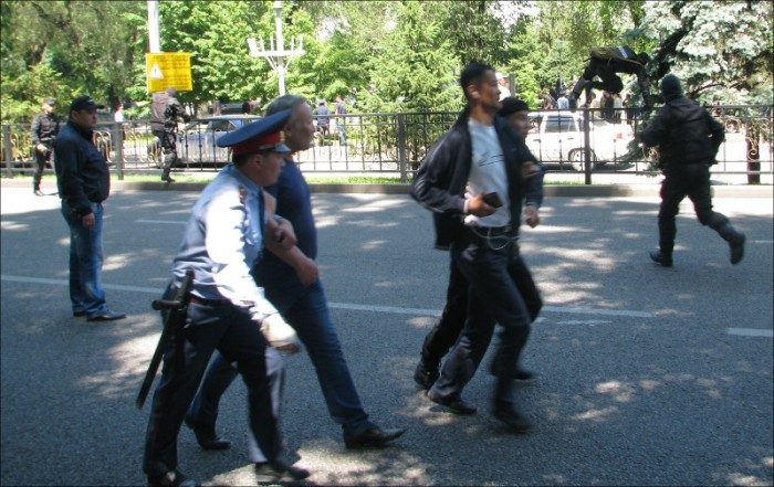 Police detaining protesters in Almaty on Saturday, May 21, 2016
