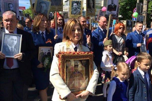 "Crimea Prosecutor General Natalia Poklonskaya leading the Immortal Regiment in Simferopol, Crimea, May 9, 2016. According to TASS, she carried a ""wonder-working"" icon of Holy Martyr Tsar Nicholas II."