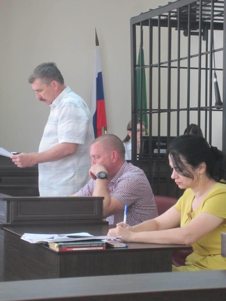 Valery Brinink (left) and his attorney,