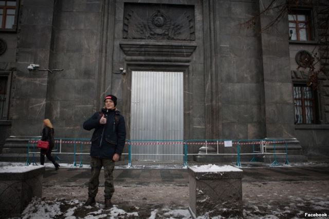 Gleb Astafiev standing next to the door at FSB headquarters that Pyotr Pavlensky set on fire