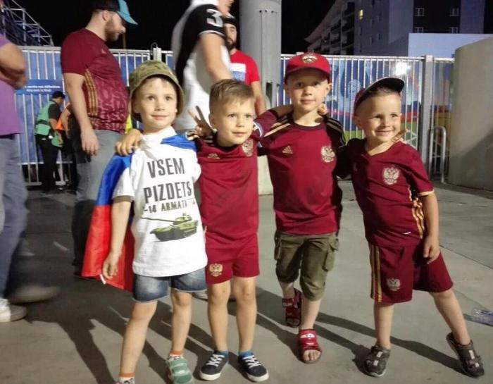 "Young Russian football fans at the European Championships in France. The youngster on the far left, draped in a Russian flag, is a wearing a t-short that says, ""You're all fucked. T-14 Armata."" The T-14 Armata is a new Russian battle tank that made its debut during the 2015 Victory Day parade in Moscow. Photo courtesy of Andrei Malgin"