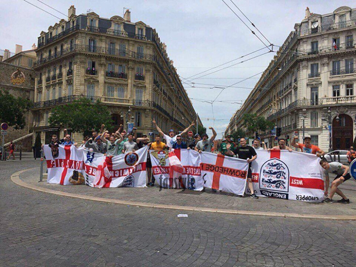 Russian football hooligans displaying captured English flags. Photo courtesy of tribuna.sports.ru