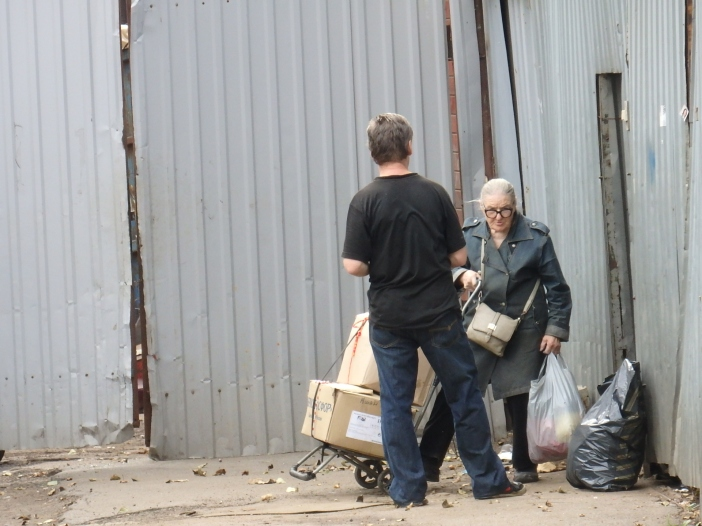 An elderly woman turning in scrap paper and other junk to supplement her pension.
