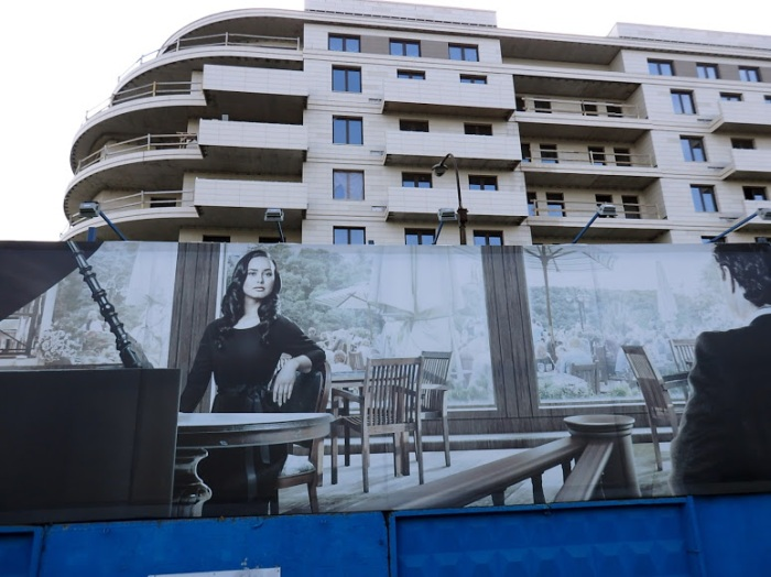 "The large hoardings that double as a construction site fence are chockablock with stock images of god knows who enjoying lives of ""privilege"" god knows where."