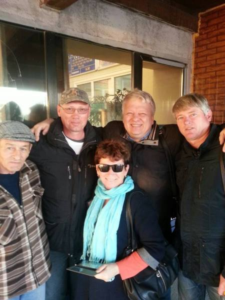 Leonid Tikhonov (second from left) after his release from prison. Photo courtesy of Ivan Ovsyannikov and MPRA